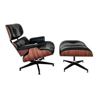 1990s Third Generation Eames Black Leather and Walnut Lounge Chair and Ottoman - a Pair For Sale