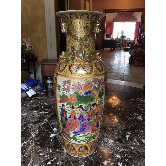 20th century pair of tall Chinese vases with decorative scenes.