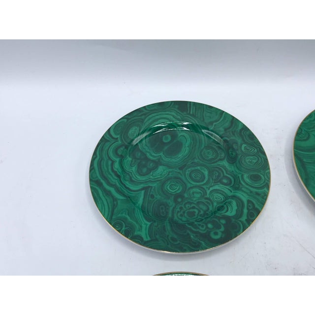 Offered is a stunning set of four, 1980s Neiman Marcus malachite dessert plates with a gold 24-karat band around the...