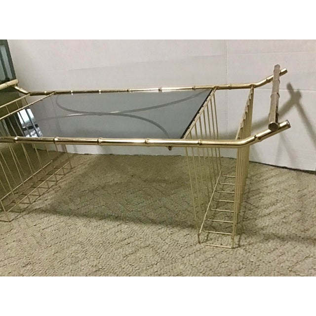 Hard to find, mid-century faux bamboo bed tray with a pair of left-right magazine holders. Made of metal, to look like...