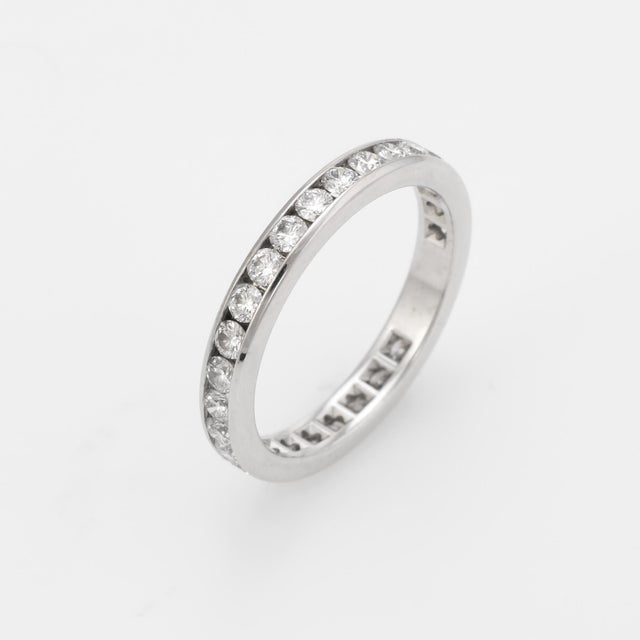 Pre owned Tiffany & Co diamond wedding band, crafted in 950 platinum. 28 round brilliant cut diamonds are channel set into...
