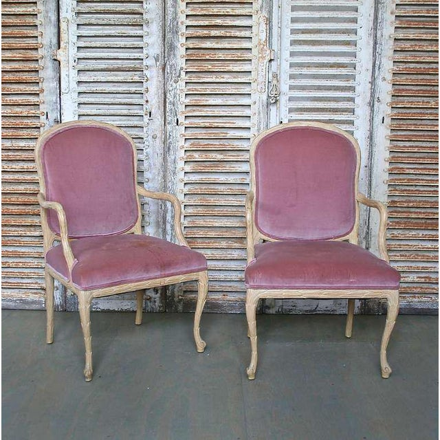 Set of six hand-carved dining chairs (two Armchairs and four without arms). Frames have carved overlapping leaves in a...