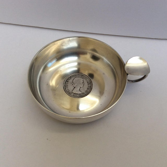 Charming vintage Sterling silver wine taster with coin built into the base. 1958 coin