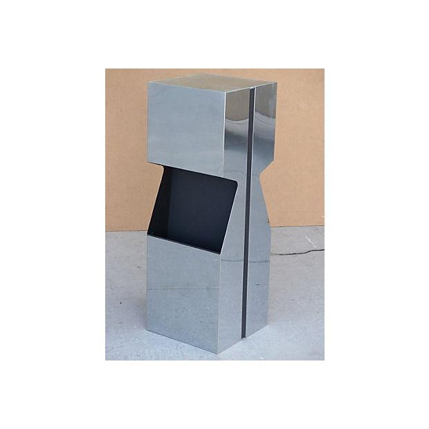 Chrome and black-painted metal light up pedestal by George Kovacs with inset frosted glass top and chrome foot switch....