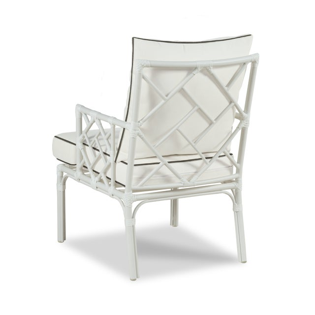 Features a fretwork back and arms and detachable cushions. Made of powder coated aluminum with a weatherproof...