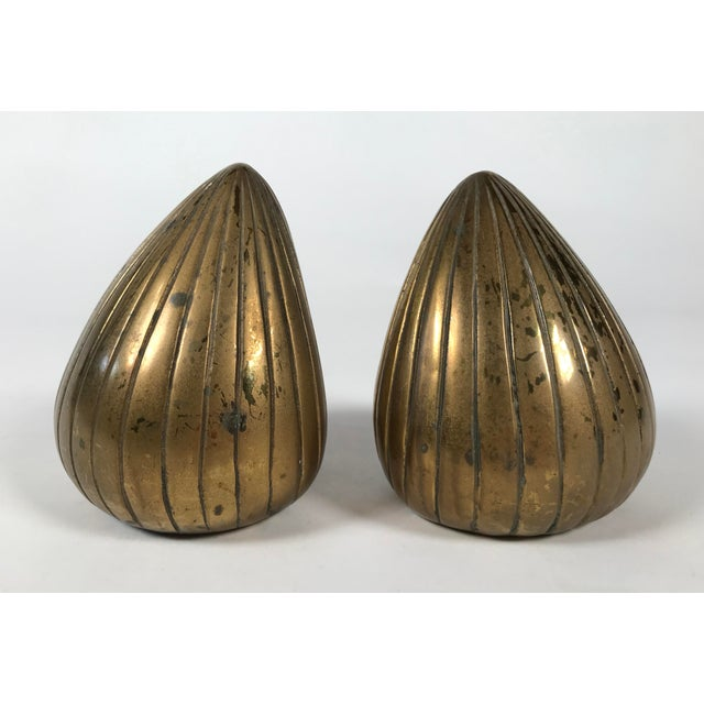 """Brass bookends designed by Ben Seibel for Jenfred Ware, circa 1950. Design often referred to as """"seed"""" or """"clam"""" bookends...."""