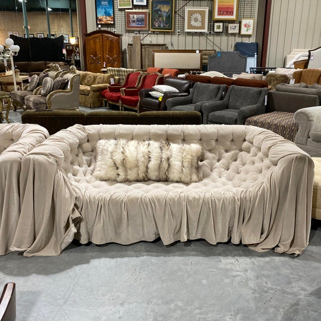 A beautiful pair of custom made tufted sofas handmade in Italy and brought over to a high end store in Greenwich, Ct. The...