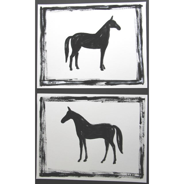 A pair of abstract horse paintings in black and white on a white background. A contemporary must for any horse lover....