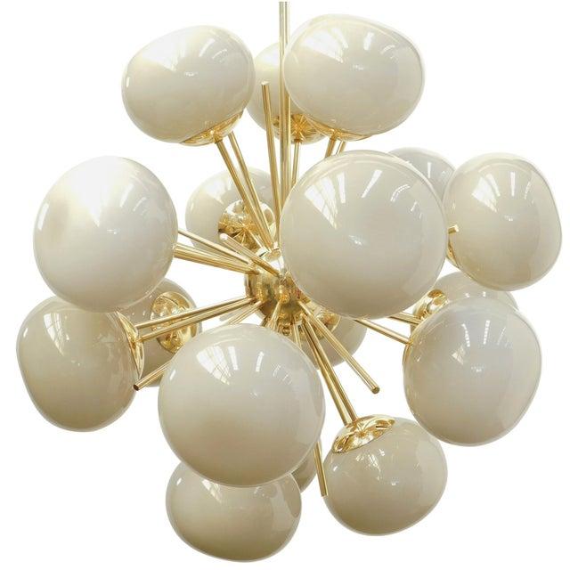 Italian chandelier with 18 light gray Murano glass pebbles on polished brass frame / Designed by Fabio Bergomi for Fabio...