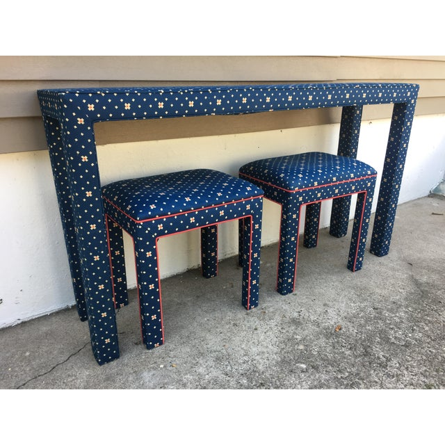 70s upholstered parsons console table and matching benches. The parson table is upholstered in a blue fabric with white...