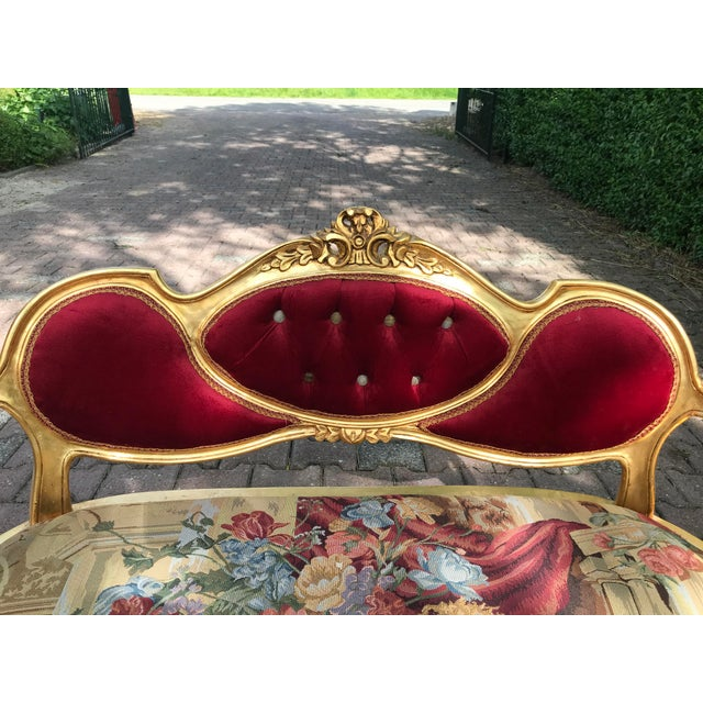 A wonderful French Louis XVI sofa. The sofa was recently upholstered with (tufted) velvet for the back and armrests and...