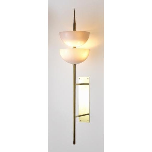 The Gilles Grand Scaled Walled Sconce by Studio Van den Akker features a body in hand waxed unlacquered brass with two...