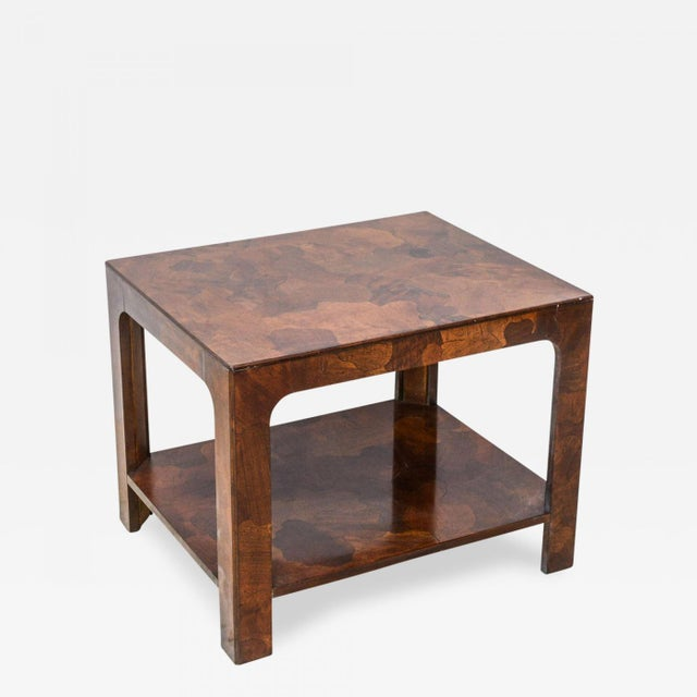 The exotically inlaid mixed wood veneers with square legs and a shelf, can be sold separately or together with companion...