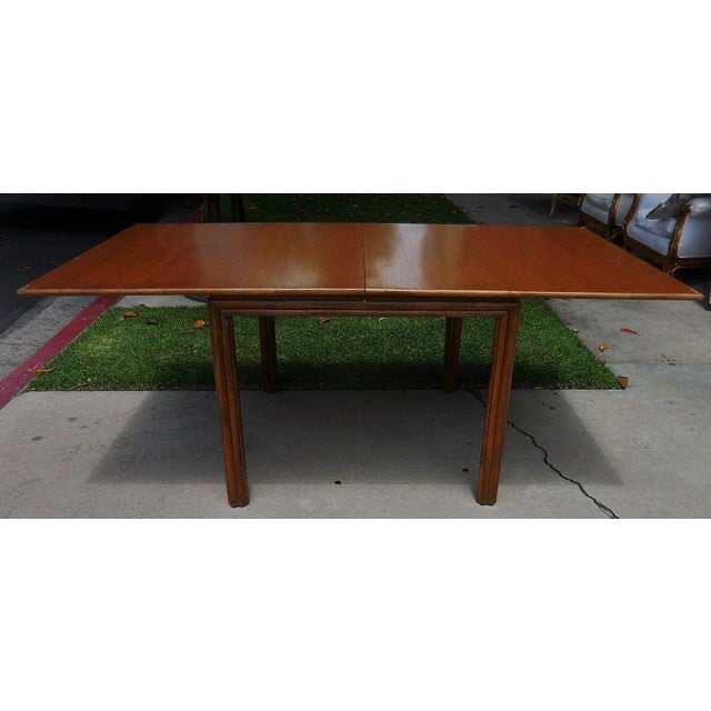 Fine designer breakfast dining table by McGuire Furniture Company in excellent condition. This lovely table is genuine...