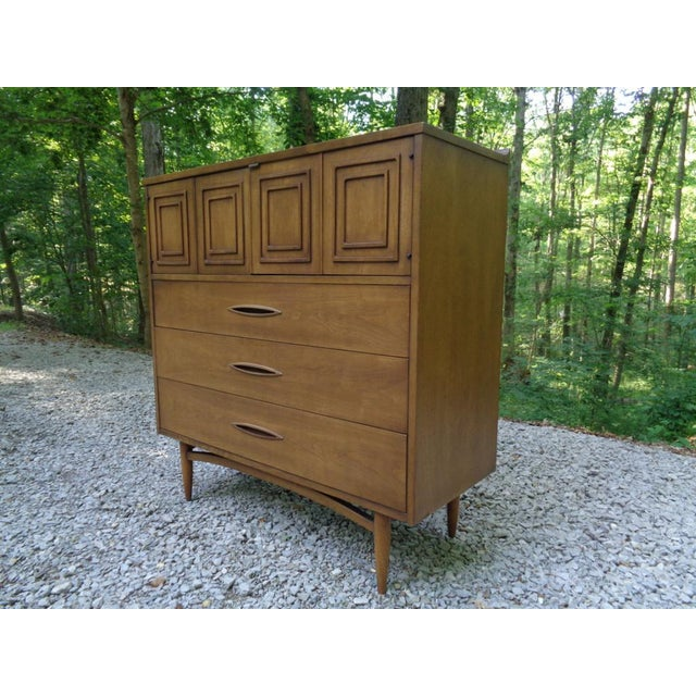Mid century modern Broyhill Sculptra tall dresser/gentleman's chest ~ dated 1961. Upper bifold doors with distinct...