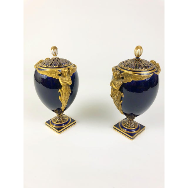 These two English pomander urns/vases from Worcester feature perforated lids to allow the scent of potpourri to waft into...