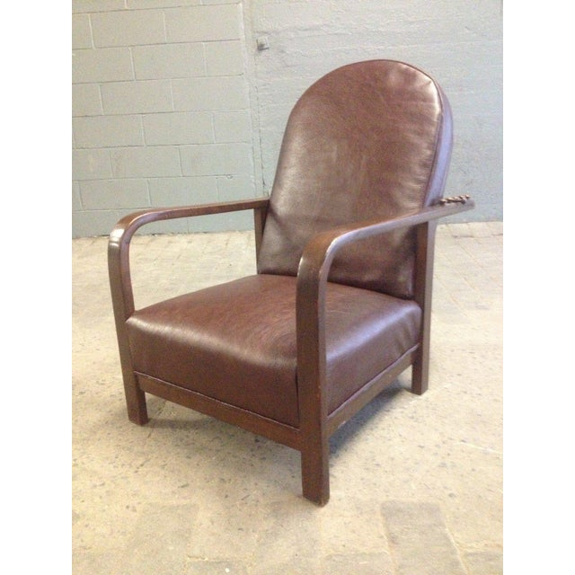 Josef Hoffman reclining armchair with a bentwood frame in stained birch. Has an iron bar to adjust reclining positions.