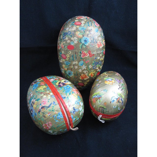 Popular during the Victorian era, this group of three German papier-mâché, egg-shaped Holiday candy containers are covered...