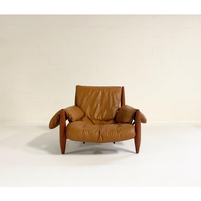 'Sheriff' lounge chair and ottoman, in Brazilian wood and leather, by Sergio Rodrigues for I.S.A. Italy, Italy, 1961. This...