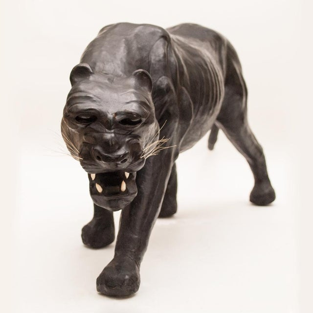 Striking large midcentury leather wrapped panther sculpture with glass eyes and inserted canines. Detailed. Excellent...