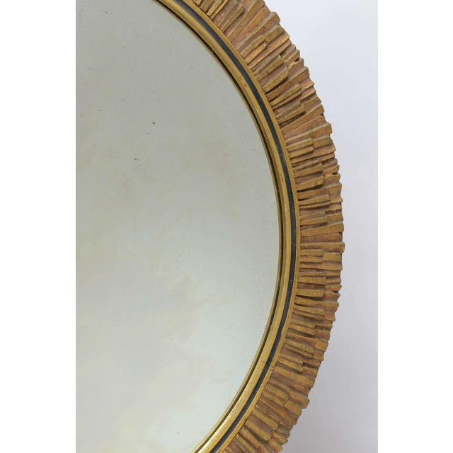 This chic sunburst mirror crafted of inlaid, hand-cut pieces of gilded wood. The mirror itself is beveled and contains...