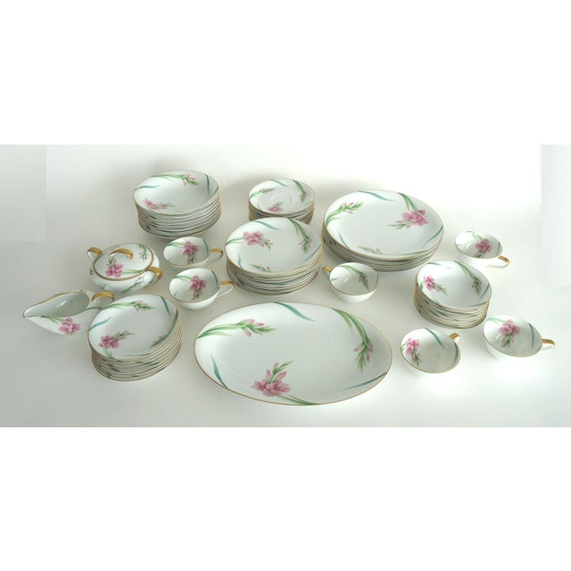 The lot includes the following pieces in the Noritake pattern with gladiola flowers: 6 dinner plates 8 soup bowls 8 salad...