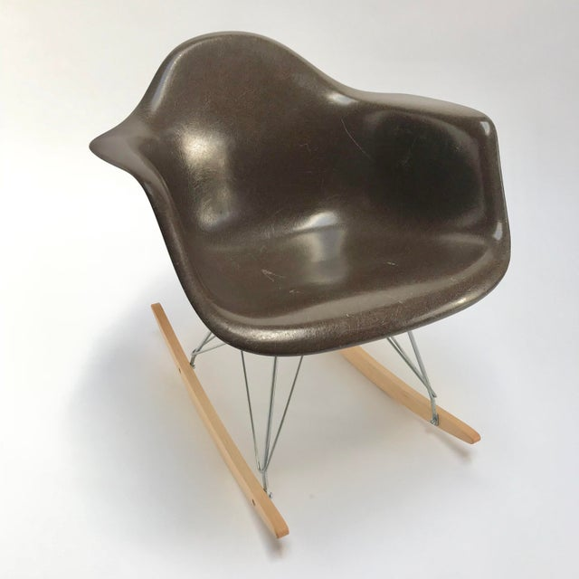 Vintage Eames Rocking Chair with original vintage Herman Miller shell on a new reproduction rocking base. Dark brown...