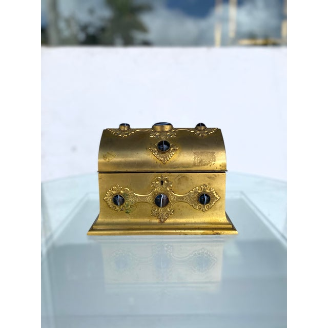 A gilt metal box have bezel set agate stones. Fantastic details in the georgian style