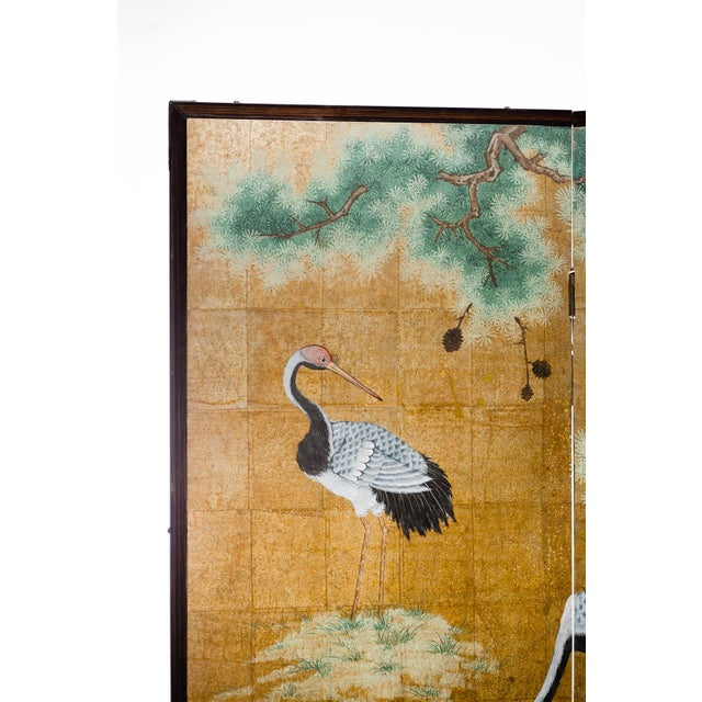 The magnificent hand-painted 2-panel screen shows four cranes in a calming and resting scene. Cranes are Asian symbols of...