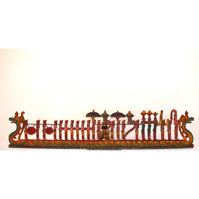 An antique, 1920's, asian carved polychrome panel. Large serpents with a long parade of musicians riding along. Very...