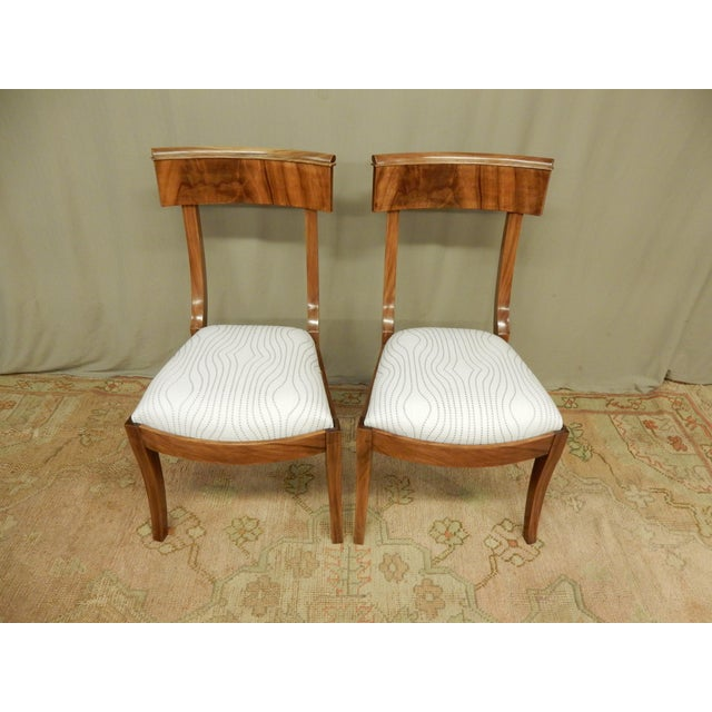Pair of 19th century Neo-Classical Empire side chairs. Restored to original patina and structurally sound.