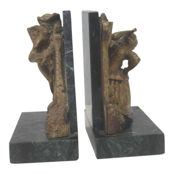 These fun and funky bookends have monkeys on each bookend with hats on and mounted on green marble bases. The condition is...