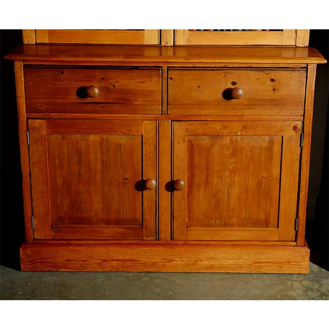 This Cabinet is thought to be English and from the 19th century. The top section has two glazed doors and allows for lots...