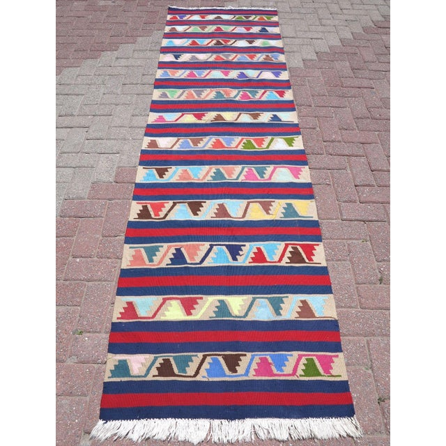 This beautiful, vintage, handwoven kilim is approximately 60 years old. It is handmade of wool and acrylic in all natural...