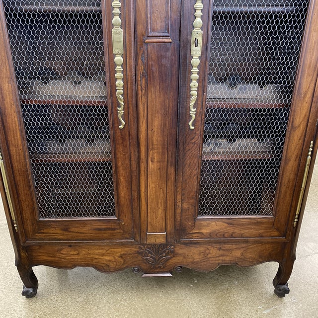 19th Century French Louis XV Provincial double door dome top armoire. Door panels with wire inserts and shelving for wine...