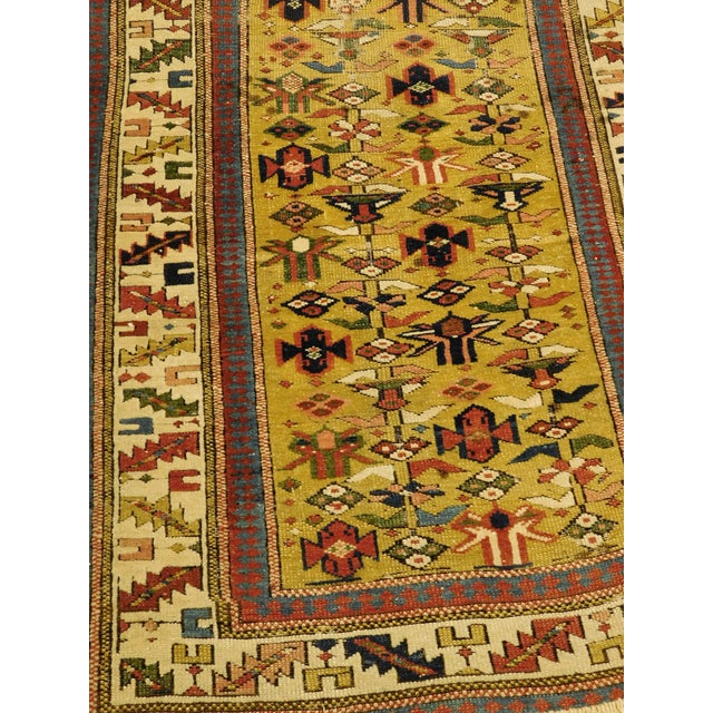 "Rare and unusual gold ground filled with geometric motifs. Cream border decorated with geometric shapes. 2'4""x 6'4"""