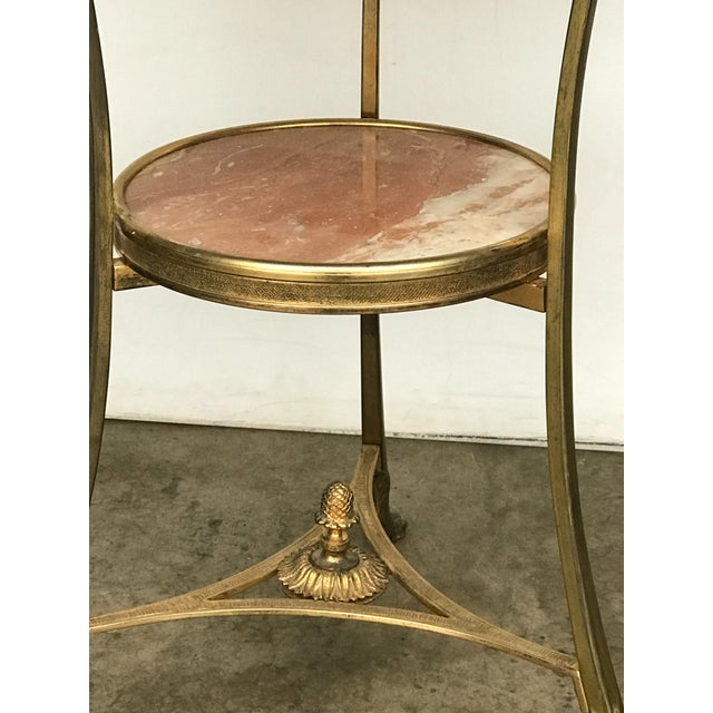 Early 20th century bronze doré gallery two tiered table supported by hairy paw feet. Made in the style of French.