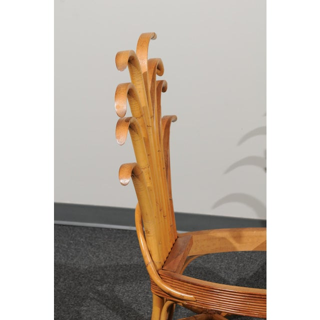 An absolutely majestic set of eight (8) of custom made palm frond style dining chairs, circa 1950. Exceptionally conceived...
