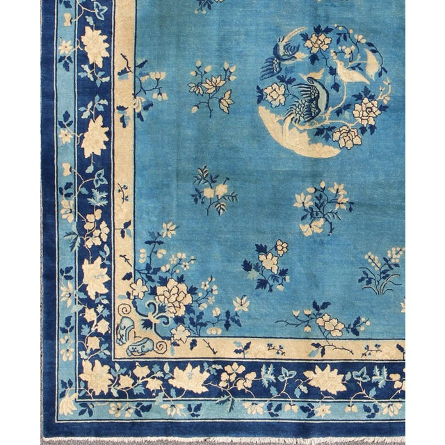 Alive with color and exotic patterns, this beautiful antique Peking Chinese rug features a traditional Chinese design in...
