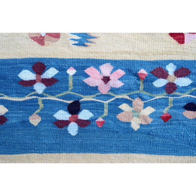 Handmade vintage Bessarabian kilim from Romania in blue and yellow colours. Vegetable dyes, the rug is in original good...