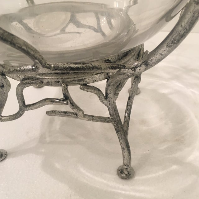 This handmade glass bowl sits in a branch design metal stand finished in antique silver.