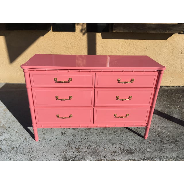 Stunning little 6 drawer vintage dresser. It has that tropical vintage Palm beach vibe. The super glossy finish on this...