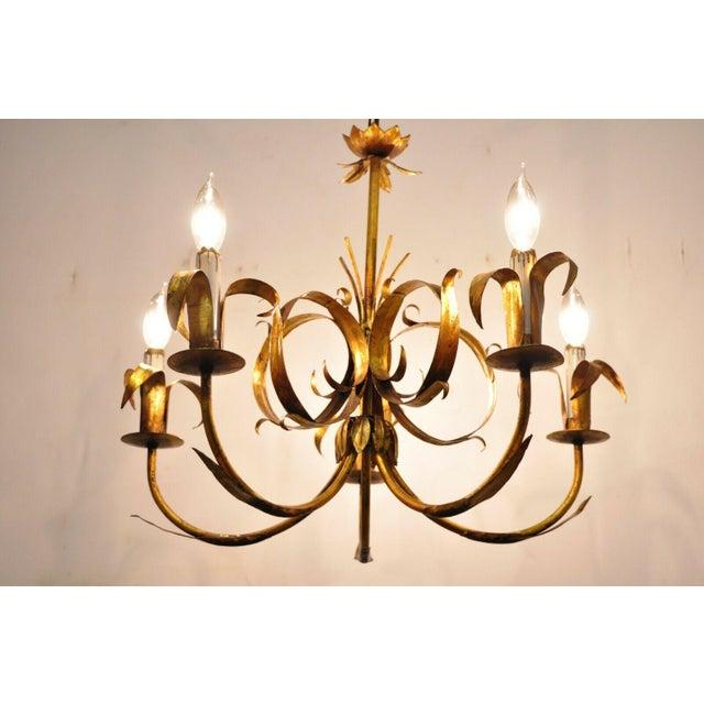 Vintage Italian Hollywood Regency Gold Gilt Tole Metal Chandelier by Ferrocolor Spain. Item features 5 lights, leafy...