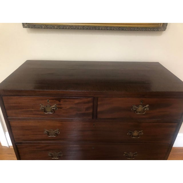 "A very handsome ""2 over 3"" English chest in very good condition. Banded drawers and bracket feet on this chest with great..."