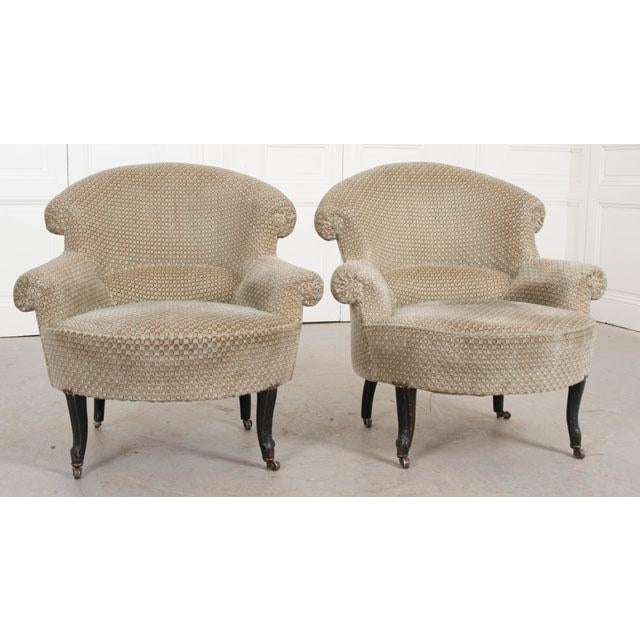 A fantastic pair of upholstered English tub chairs. This comfortable pair was constructed towards the end of the 19th...