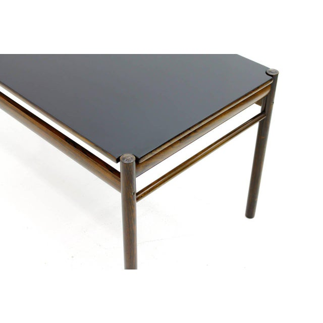 Beautiful flip-top sofa table in Rosewood and black lacquer by Ole Wanscher for Jeppesen Denmark from the Colonial Series,...