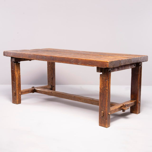 Sturdy rustic oak table found in France, circa 1830s. Top consists of four oak planks, stretchers are joined with mortice...