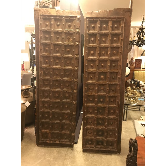 This is a beautiful pair of hand-made doors from an ancient Indian building. These doors are magnificent and regal, they...