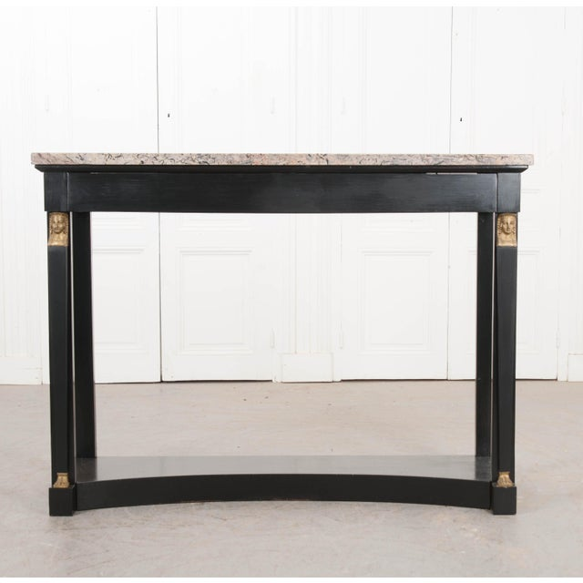 This classic Empire-style ebonized and marble-top console table, c. 1870, is from France. The beautiful marble top...