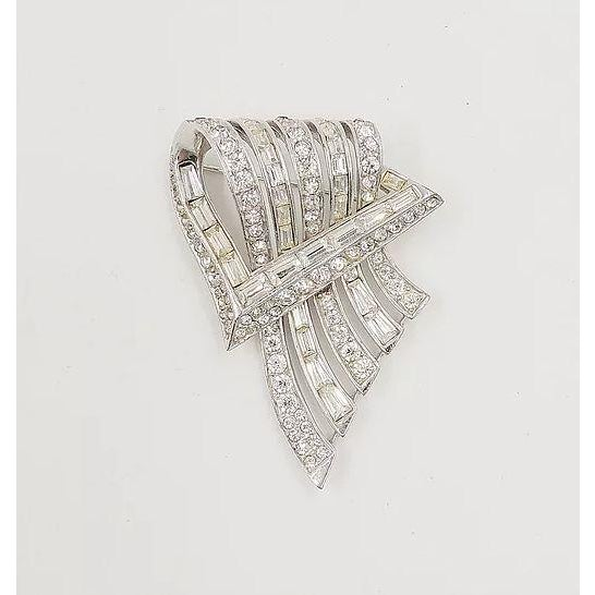 """Rhodium plated baguette and round clear rhinestones brooch with security clasp. Marked """"Boucher"""" with inventory number """"..."""